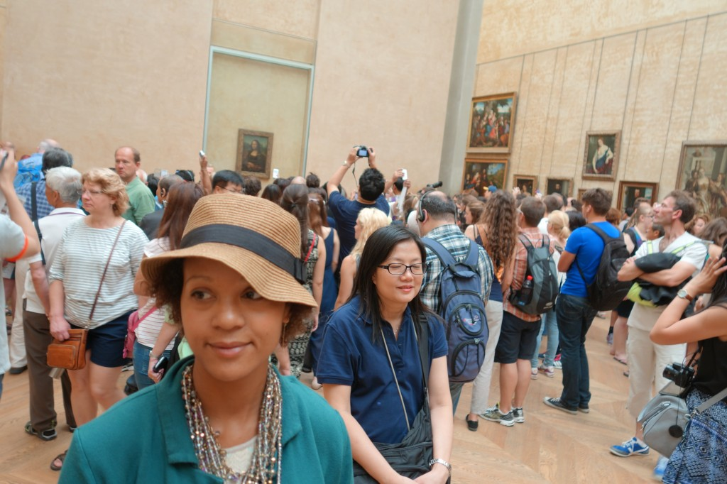 Frau Kolb among the crowds, visiting the Mona Lisa at the Louvre in Paris, France.  Summer, 2014