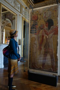 Frau Kolb is taking in the pictorial art of the ancient Egyptians at the Louvre in Paris, France
